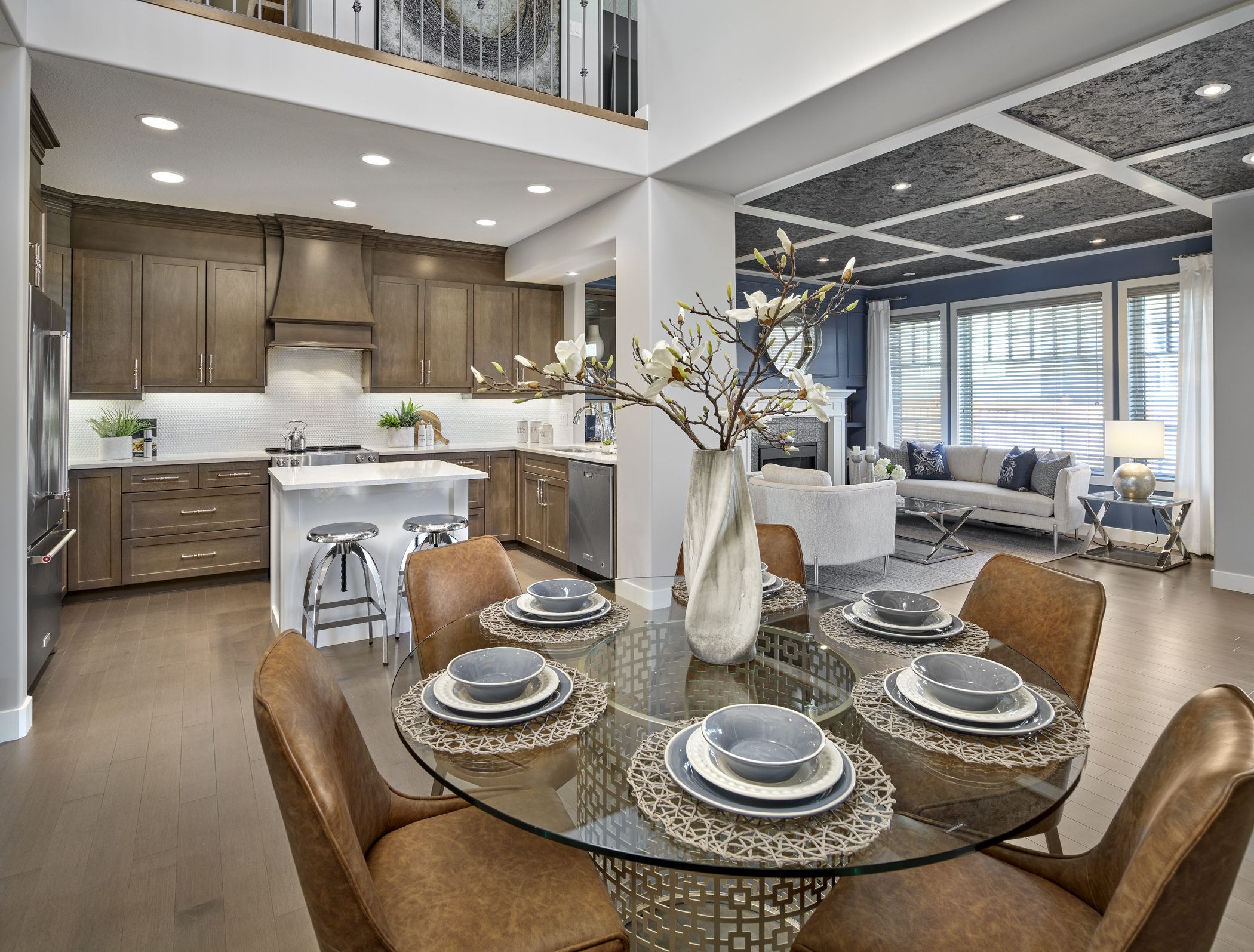 Open concept main floor of a home decorated in earth tones with blue accents